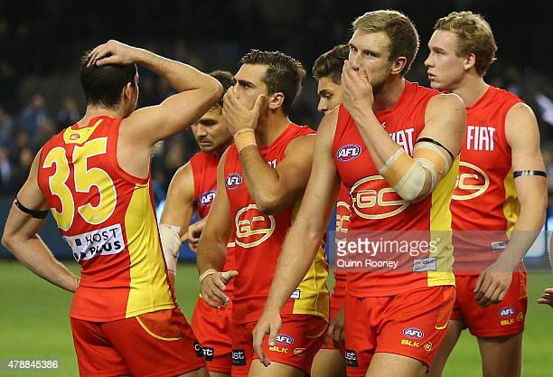 The Suns look dejected after losing the round 13 AFL match between the Carlton Blues and the Gold Coast Titans at Etihad Stadium on June 28 2015 in...