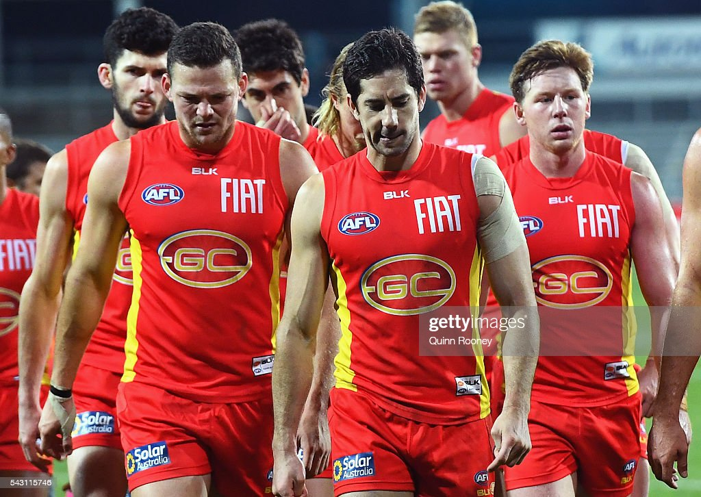 The Suns look dejected as they leave the field after losing the round 14 AFL match between the Hawthorn Hawks and the Gold Coast Suns at Aurora Stadium on June 26, 2016 in Launceston, Australia.
