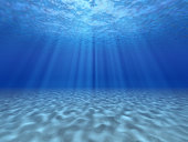 The sun's rays underwater. Underwater background.