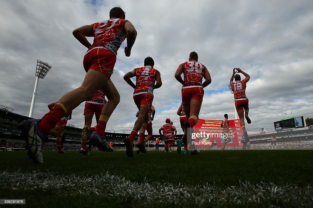 The Suns run onto the field during the round 10 AFL match between the West Coast Eagles and the Gold Coast Suns at Domain Stadium on May 29, 2016 in Perth, Australia.