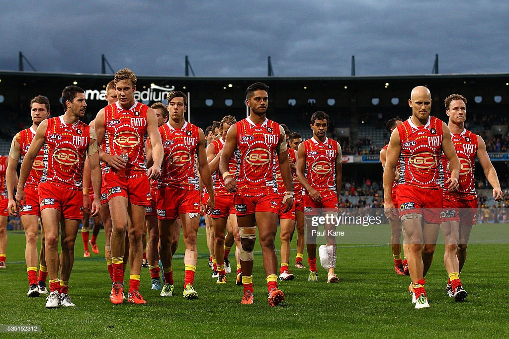The Suns walk from the field after being defeated during the round 10 AFL match between the West Coast Eagles and the Gold Coast Suns at Domain Stadium on May 29, 2016 in Perth, Australia.