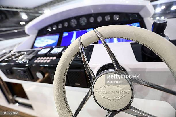 The Sunseeker International Ltd company logo sits on display on the steering wheel of a yacht at the London Boat Show in London UK on Friday Jan 6...