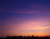 Beautiful multicolored sunset over a dark cityscape. You can find my other similar photos here