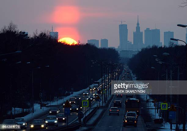 The sunsets behind the skyline of the city of Warsaw Poland on March 22 2013 AFP PHOTO/JANEK SKARZYNSKI