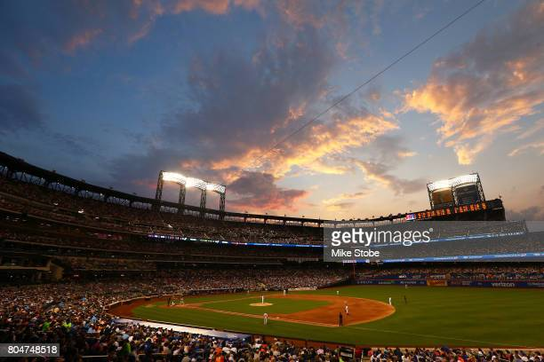 The sunsets in the fourth inning during the game between the New York Mets and the Philadelphia Phillies at Citi Field on June 30 2017 in the...
