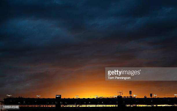 The sunsets over the grandstands during qualifying for the NASCAR Sprint Cup Series AdvoCare 500 at Phoenix International Raceway on November 9 2012...