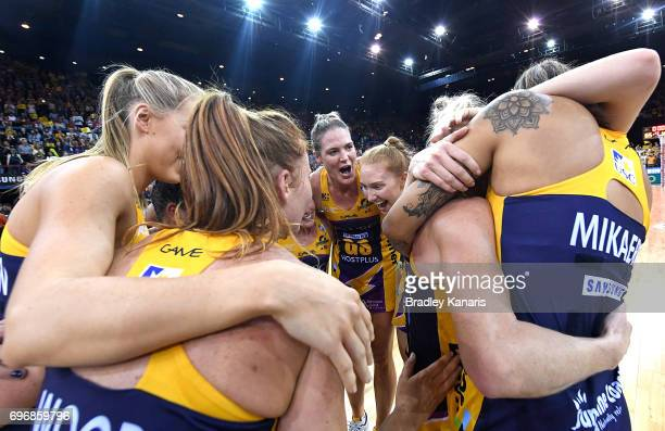 The Sunshine Coast Lightning players celebrate victory after the Super Netball Grand Final match between the Lightning and the Giants at the Brisbane...