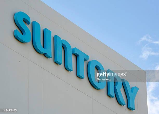 The Suntory Holdings Ltd logo is displayed atop a building at the company's Musashino brewery in Tokyo Japan on Thursday April 5 2012 Suntory...