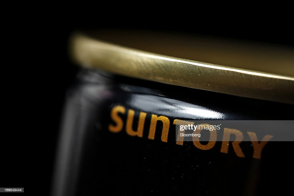 The Suntory Holdings Ltd. logo is displayed on a can of Suntory Beverage & Food Ltd.'s Boss brand coffee in this arranged photograph taken in Soka City, Saitama Prefecture, Japan, on Sunday, May 26, 2013. Nomura Holdings Inc., Morgan Stanley and JPMorgan Chase & Co. were selected as the lead banks to manage Suntory Beverage & Food Ltd.'s initial public offering, said two people with knowledge of the matter. Photographer: Kiyoshi Ota/Bloomberg via Getty Images