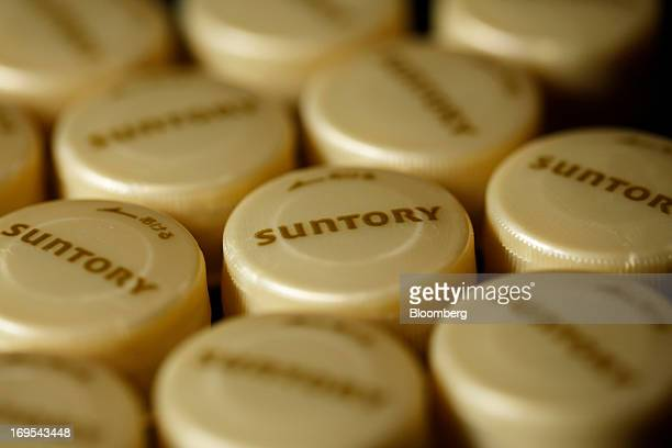 The Suntory Holdings Ltd logo is displayed on bottle caps for Suntory Beverage Food Ltd's Kuro Oolong tea are arranged for a photograph in Soka City...