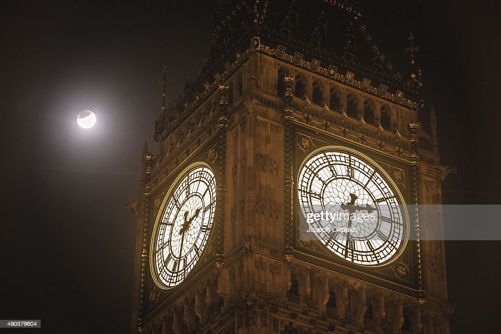 The Super Blood Moon is seen during the early stages of the Lunar Eclipse near Big Ben on September 28, 2015 in London, United Kingdom. The Super Moon coincides with a total lunar eclipse, a rare combination that last occured in 1982.