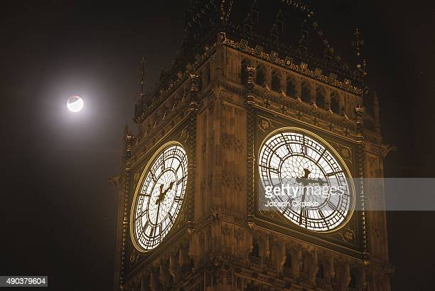The Super Blood Moon is seen during the early stages of the Lunar Eclipse near Big Ben on September 28 2015 in London United Kingdom The Super Moon...
