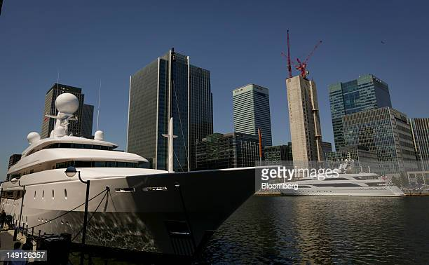 The super yachts ''Ilona'' owned by Westfield Group chairman Frank Lowy left and ''Seanna'' sit moored at South Quay in the Canary Wharf business...