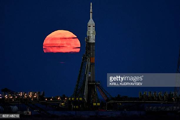 The supermoon is seen behind the Soyuz MS03 spacecraft set on the launch pad at the Russianleased Baikonur cosmodrome in Kazakhstan on November 14...