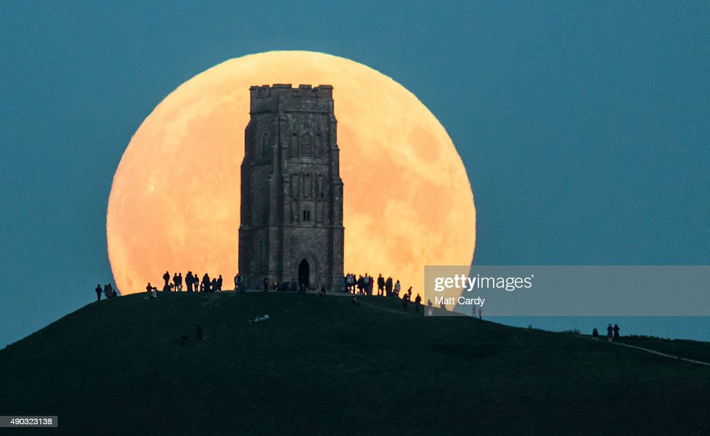 The supermoon rises behind Glastonbury Tor on September 27, 2015 in Glastonbury, England. Tonight's supermoon, so called because it is the closest full moon to the Earth this year, is particularly rare as it coincides with a lunar eclipse, a combination that has not happened since 1982 and won't happen again until 2033.