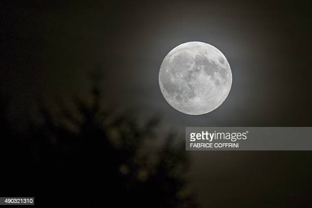 The 'supermoon' rises on September 27 2015 in Lausanne For the first time in decades skygazers are in for the double spectacle Monday of a swollen...