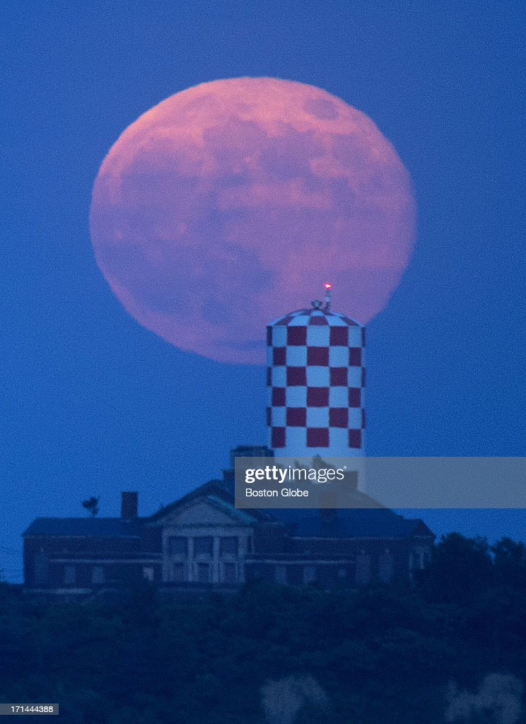 The Supermoon seen from Castle Island, rising behind Long Island, in Boston, Mass., Sunday, June 23, 2013. The moon disappeared into the clouds as it rose.