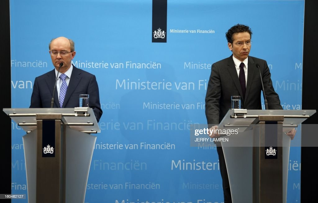The supervising director of the Nederlandsche Bank, Jan Sijbrand (L), and Dutch Finance Minister Jeroen Dijsselbloem (R) give a press conference on February 1, 2013 in The Hague to announce that the Dutch state had nationalized banking and insurance group SNS Reaal at a cost of 3.7 billion euros (5 billion US dollars), averting a threat to the Dutch financial system. The bank is known as the fourth-biggest in the Netherlands, and the finance ministry said in a statement that savings deposited there were safe. AFP PHOTO / ANP / JERRY LAMPEN - netherlands out -