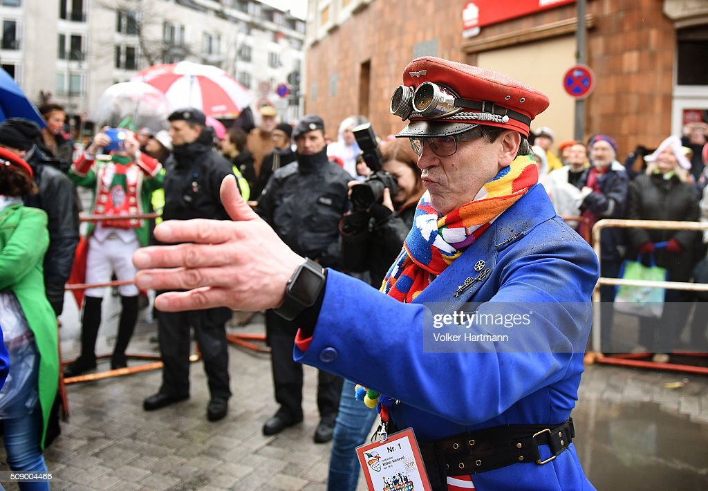 The supervisor of the carnival parade, Christoph Kuckelkorn gives the signal to start during the annual Rose Monday parade on February 8, 2016 in Cologne, Germany. The centuries-old tradition of German carnival occurs in February and runs until Ash Wednesday, the start of Lent, and culminates in Rose Monday celebrations. Police are on added alert this year, particularly in Cologne, due to the New Year`s Eve sex attacks on women that have been attributed to gangs of migrants.