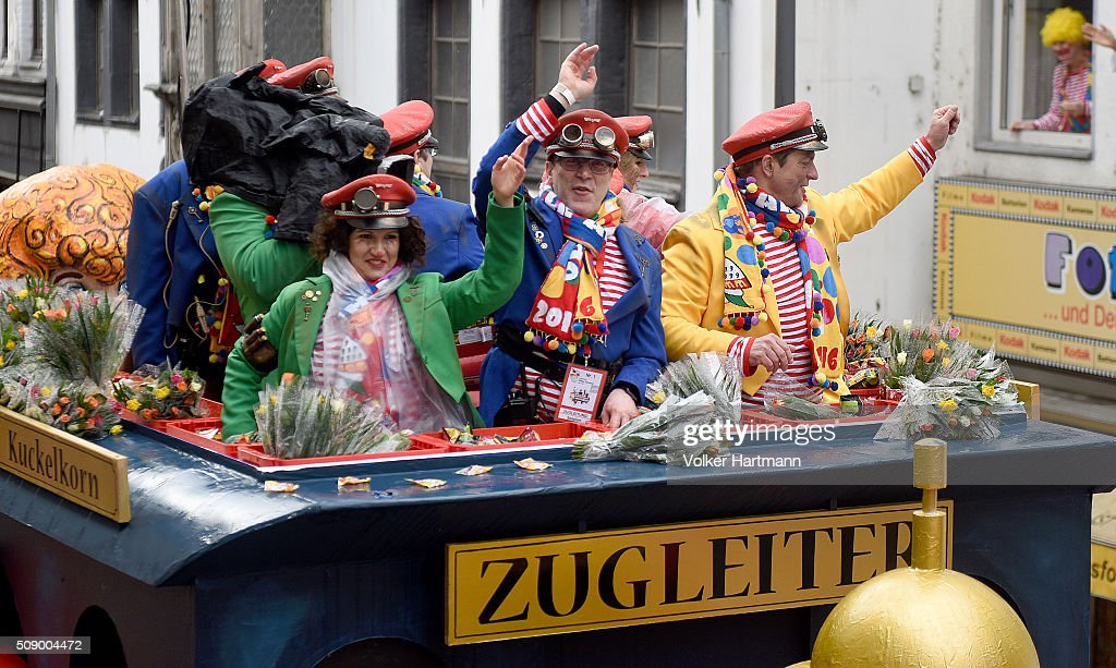 The supervisor of the carnival parade, Christoph Kuckelkorn (blue Jacket) waves from a float during the annual Rose Monday parade on February 8, 2016 in Cologne, Germany. The centuries-old tradition of German carnival occurs in February and runs until Ash Wednesday, the start of Lent, and culminates in Rose Monday celebrations. Police are on added alert this year, particularly in Cologne, due to the New Year`s Eve sex attacks on women that have been attributed to gangs of migrants.