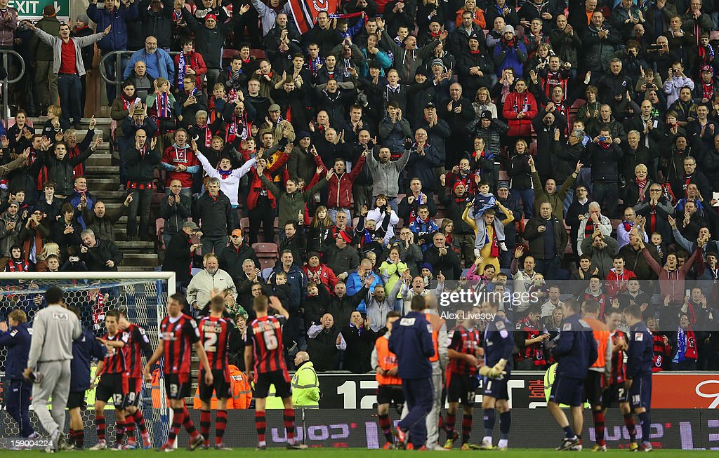 The supporters of AFC Bournemouth applaud their players after the Budweiser FA Cup Third Round match between Wigan Athletic and AFC Bournemouth at DW Stadium on January 5, 2013 in Wigan, England.