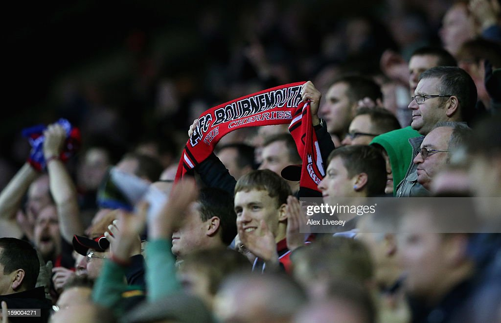 The supporters of AFC Bournemouth applaud their players during the Budweiser FA Cup Third Round match between Wigan Athletic and AFC Bournemouth at DW Stadium on January 5, 2013 in Wigan, England.
