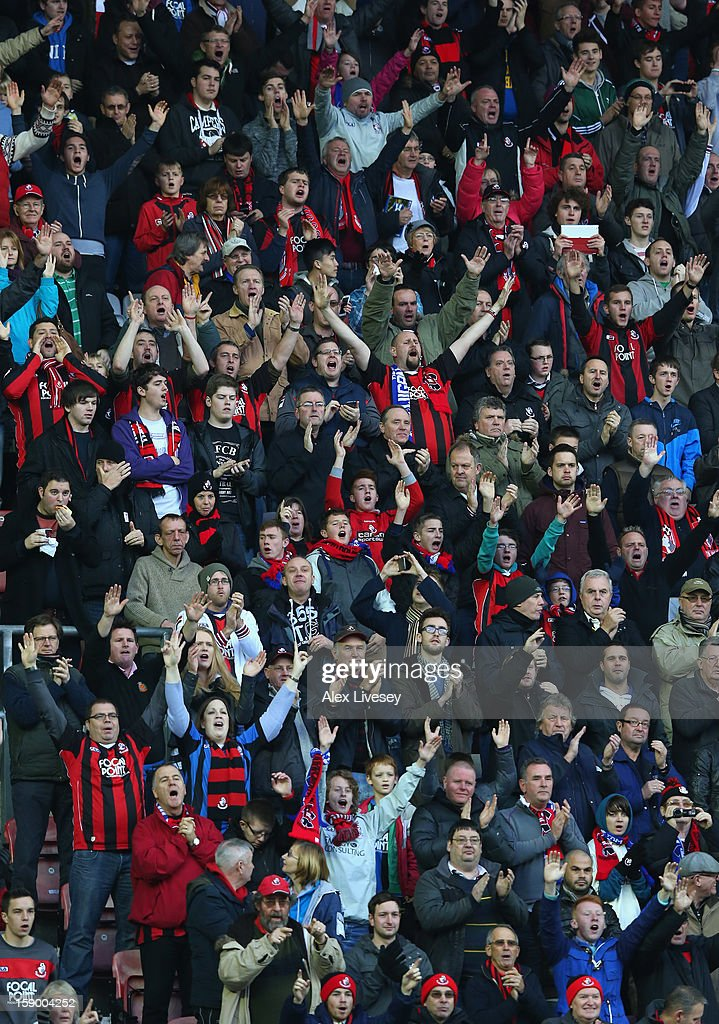 The supporters of AFC Bournemouth sing during the Budweiser FA Cup Third Round match between Wigan Athletic and AFC Bournemouth at DW Stadium on January 5, 2013 in Wigan, England.