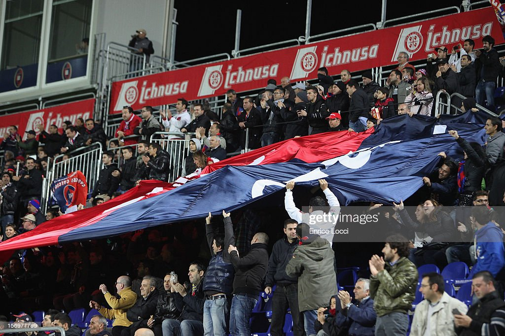The supporters of Cagliari cheer during the Serie A match between Cagliari Calcio and SSC Napoli at Stadio Sant'Elia on November 26, 2012 in Cagliari, Italy.