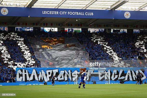 The supporters of Leicester unfurl a banner in celebration of the Premier League title winning season ahead of the Premier League match between...