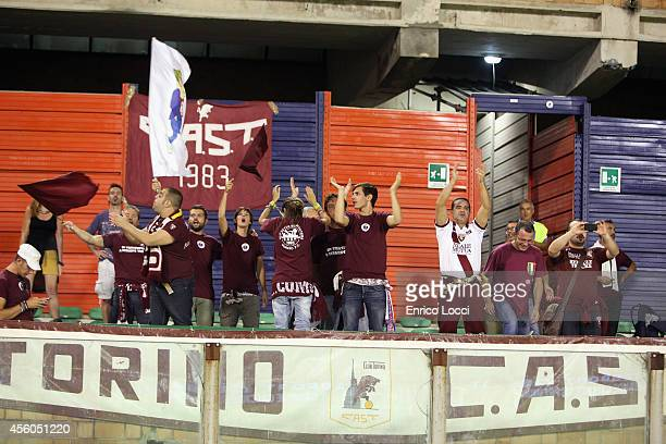 The supporters of Torino during the Serie A match between Cagliari Calcio and Torino FC at Stadio Sant'Elia on September 24 2014 in Cagliari Italy
