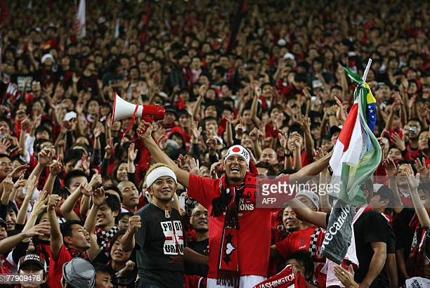 The supporters of Urawa Reds celebrate Urawa's victory against Iran's Sepahan after the game of the AFC Champions League final match at the Saitama...