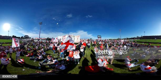 The supporters on the hill cheer as the Dragons take the field during the round 23 NRL match between the St George Illawarra Dragons and the Gold...