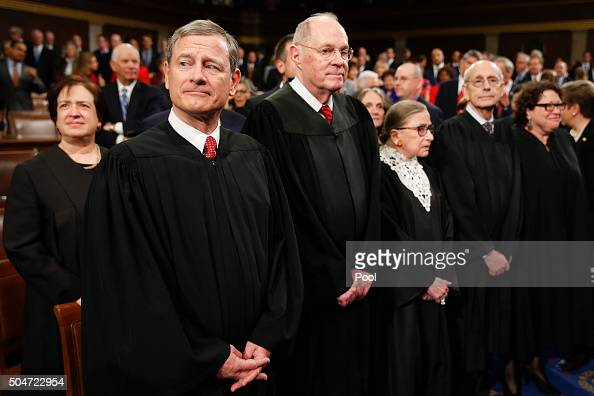 The Supreme Court Justices arrive before the State of the Union address to a joint session of Congress on Capitol Hill January 12 2016 in Washington...