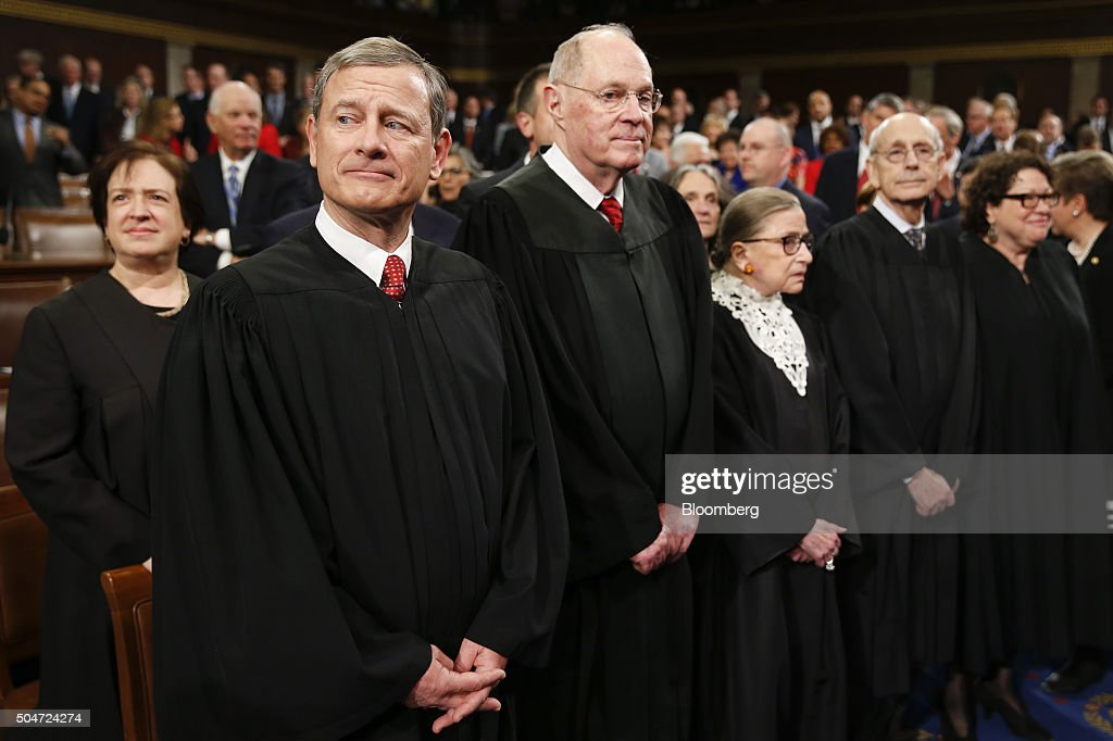 The Supreme Court Justices, from left, Chief Justice <a gi-track='captionPersonalityLinkClicked' href=/galleries/search?phrase=John+Roberts+-+17th+Chief+Justice+of+the+United+States&family=editorial&specificpeople=2220360 ng-click='$event.stopPropagation()'>John Roberts</a>, <a gi-track='captionPersonalityLinkClicked' href=/galleries/search?phrase=Anthony+Kennedy&family=editorial&specificpeople=220874 ng-click='$event.stopPropagation()'>Anthony Kennedy</a>, <a gi-track='captionPersonalityLinkClicked' href=/galleries/search?phrase=Ruth+Bader+Ginsburg&family=editorial&specificpeople=199152 ng-click='$event.stopPropagation()'>Ruth Bader Ginsburg</a>, <a gi-track='captionPersonalityLinkClicked' href=/galleries/search?phrase=Antonin+Scalia&family=editorial&specificpeople=215620 ng-click='$event.stopPropagation()'>Antonin Scalia</a>, and <a gi-track='captionPersonalityLinkClicked' href=/galleries/search?phrase=Sonia+Sotomayor&family=editorial&specificpeople=5872777 ng-click='$event.stopPropagation()'>Sonia Sotomayor</a> stand before U.S. President Barack Obama delivers the State of the Union address to a joint session of Congress at the Capitol in Washington, D.C., U.S., on Tuesday, Jan. 12, 2016. Obama said he regrets that political divisiveness in the U.S. grew during his seven years in the White House and he plans to use his final State of the Union address Tuesday night to call for the nation to unite. Photographer: Evan Vucci/Pool via Bloomberg