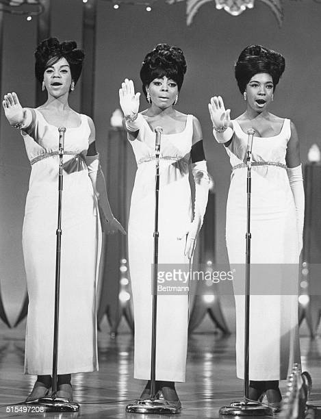 The Supremes singing in concert from left Florence Ballard Diana Ross and Mary Wilson