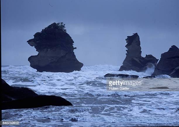 The surf churns around sea stacks off Woodpecker's Beach