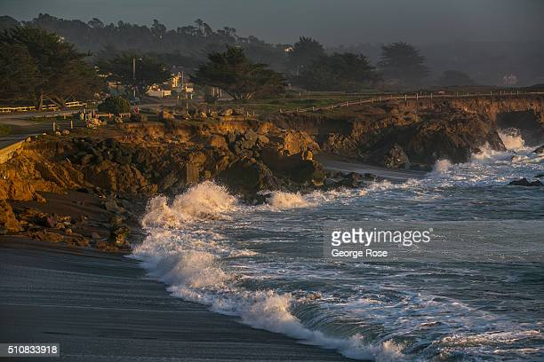 The surf crashes along the shoreline at sunset on February 4 in Moonstone Beach California Because of its close proximity to Southern California and...
