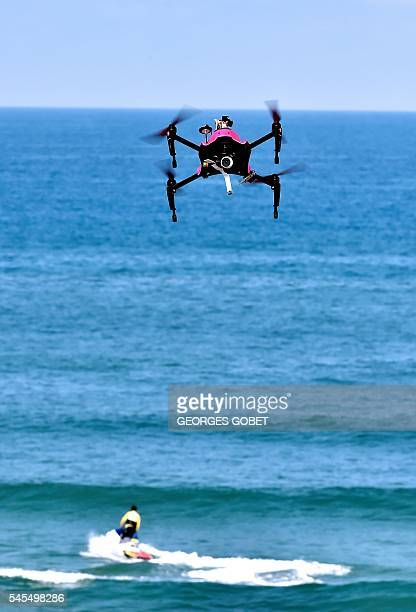 The surveillance drone 'Helper' flies over the beach of Biscarrosse on July 8 during a demonstration of a rescue operation The 'Helper' drone tested...