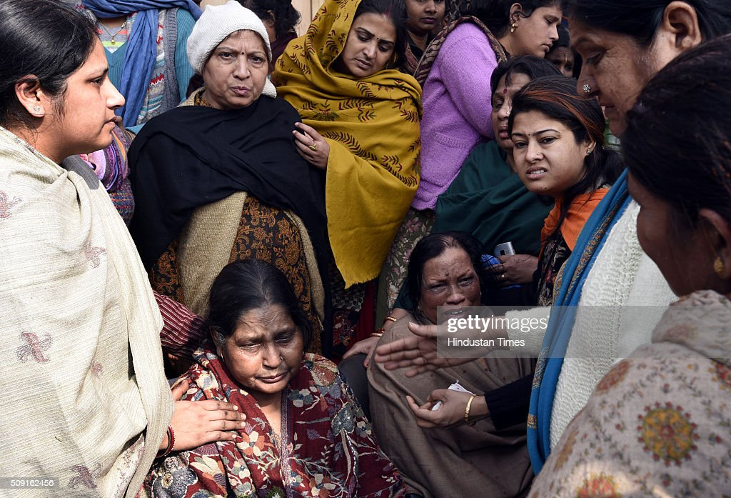 The surviving family members of the victims of the morning fire at Dilshad Garden on February 9, 2016 in New Delhi, India. A family of four died in an early morning fire that broke out in north east Delhis Dilshad Garden.