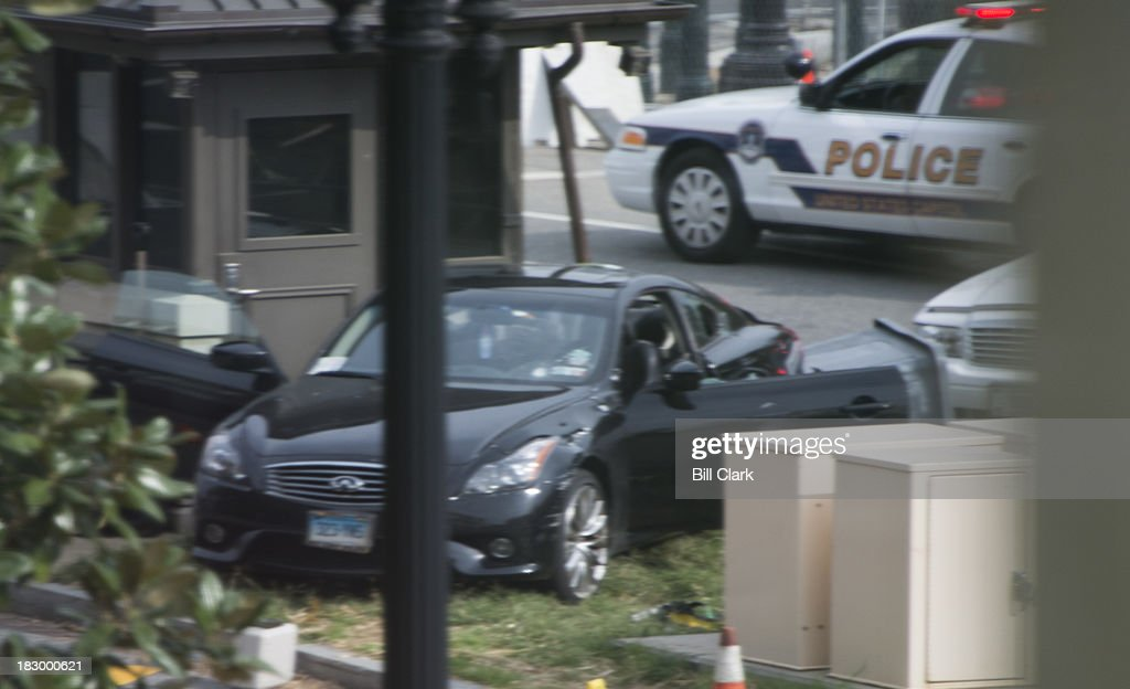 The suspect's car sits on a traffic island outside of the Hart Senate Office Building on Capitol Hill on Thursday, Oct. 3, 2013.