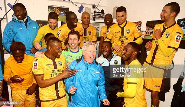 The Sutton United team celebrate their win in the changing room after The Emirates FA Cup Fourth Round match between Sutton United and Leeds United...