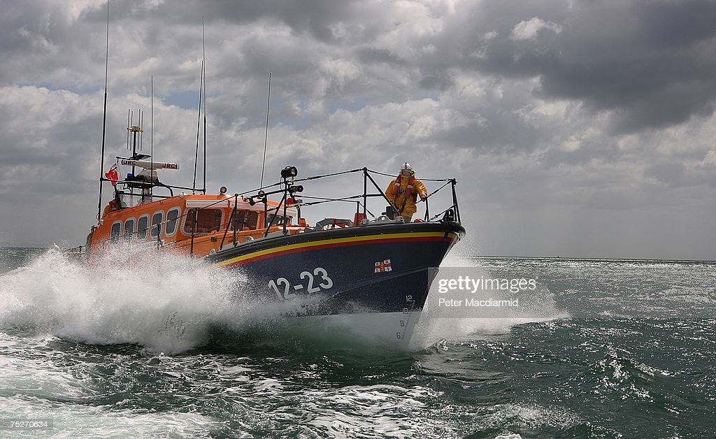 The Swanage Lifeboat of the Mersey Class cuts through the waves near Poole Harbour on July 6 2007 in Dorset EnglandThe Royal National Lifeboat...