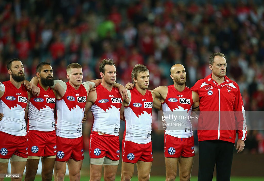 The Swans line up for the national anthem before the AFL First Semi Final match between the Sydney Swans and the Carlton Blues at ANZ Stadium on September 14, 2013 in Sydney, Australia.