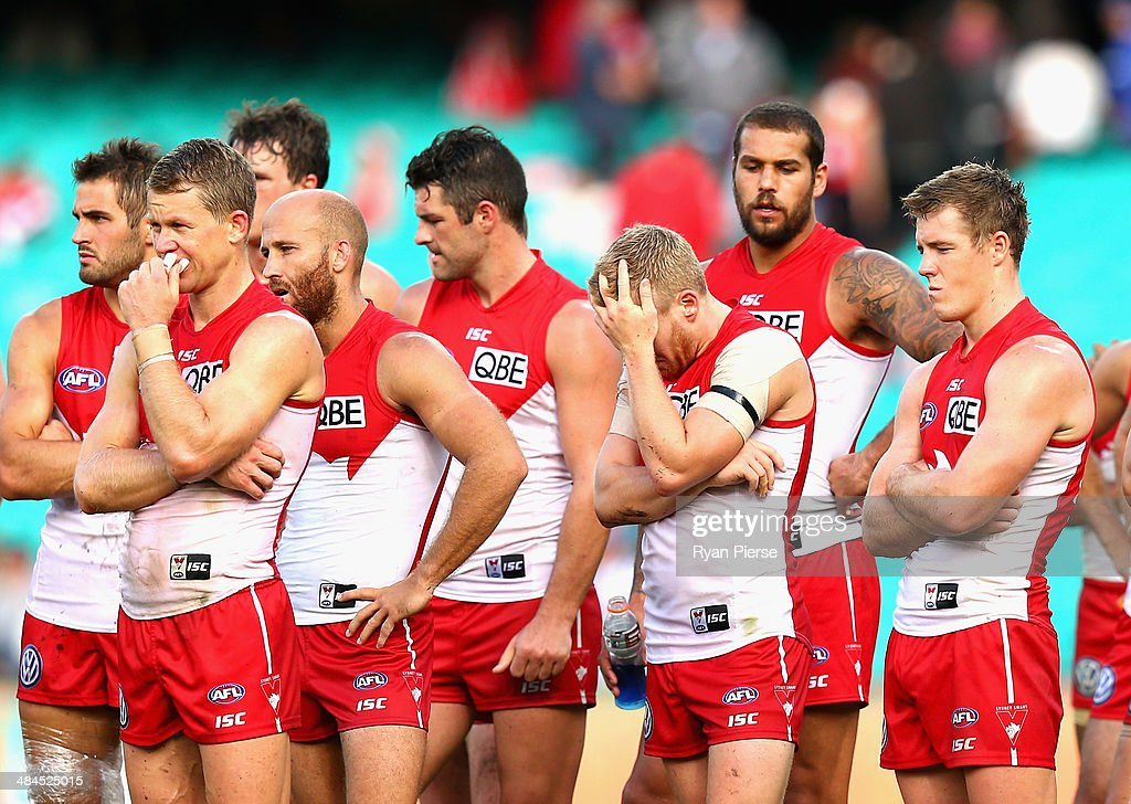 The Swans look dejected after the round four AFL match between the Sydney Swans and the North Melbourne Kangaroos at Sydney Cricket Ground on April 13, 2014 in Sydney, Australia.