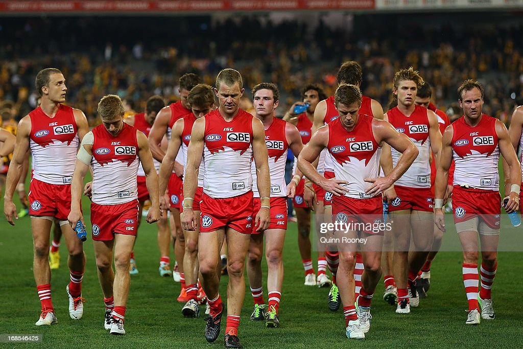 The Swans look dejected as they leave the field after losing the round seven AFL match between the Hawthorn Hawks and the Sydney Swans at Melbourne Cricket Ground on May 11, 2013 in Melbourne, Australia.