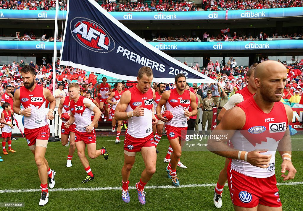 The Swans run out past their 2012 Premiership Flag before the round two AFL match between the Sydney Swans and the Gold Coast Suns at SCG on April 6, 2013 in Sydney, Australia.