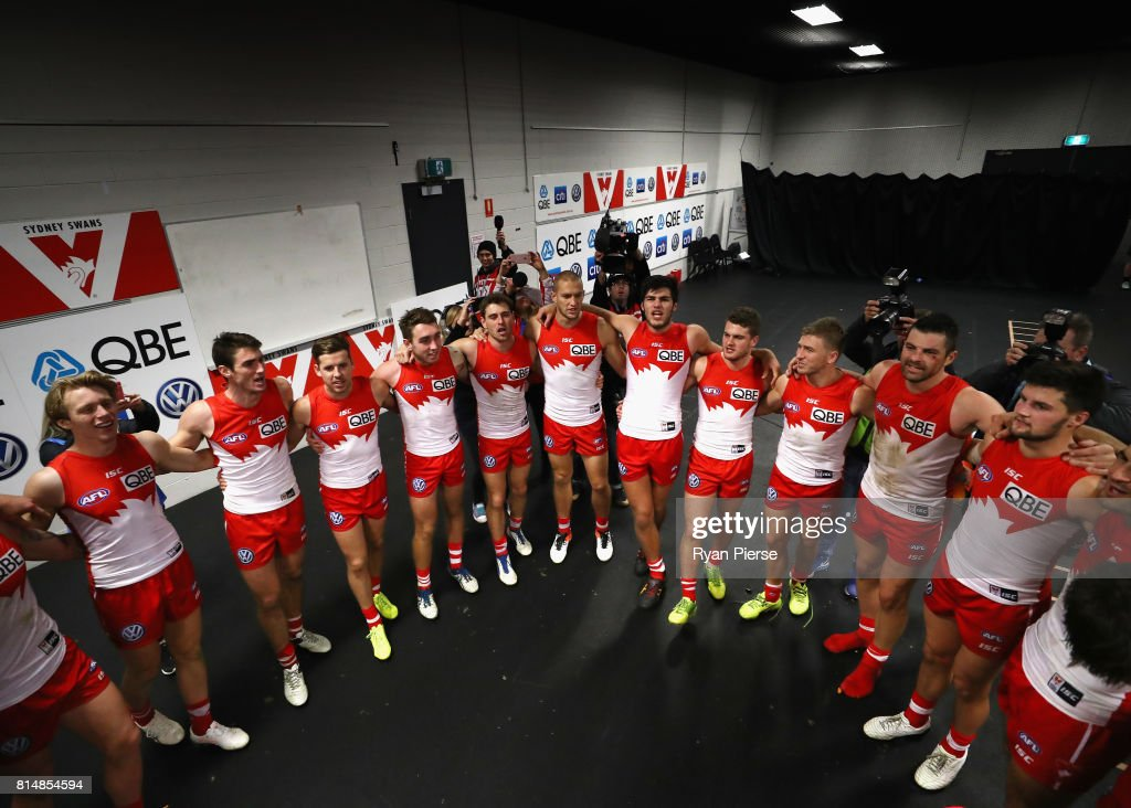 The Swans sing the club song after the round 17 AFL match between the Greater Western Sydney Giants and the Sydney Swans at Spotless Stadium on July 15, 2017 in Sydney, Australia.