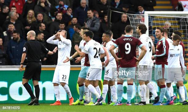 The Swansea City players appeal as referee Anthony Taylor awards a penalty to Burnley during the Premier League match between Swansea City and...