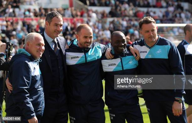 The Swansea coaching staff Nigel Gibbs Paul Clement Karl Halabi Claude Makelele and Tony Roberts pose for a picture after the Premier League match...
