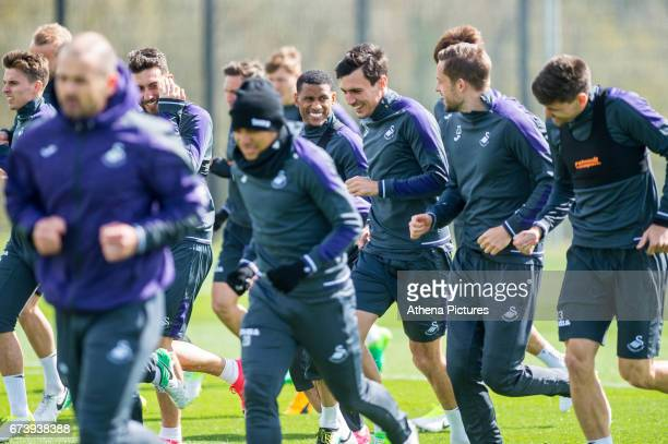 The Swansea squad including Luciano Narsingh Jack Cork Gylfi Sigurdsson and Federico Fernandez warm up during the Swansea City training session at...
